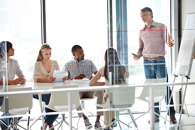 Buy stock photo A group of businesspeople sitting in a meeting
