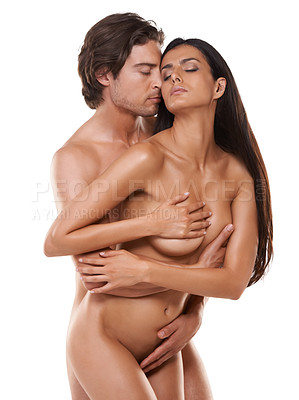 Buy stock photo Shot of a couple making lover over a white background