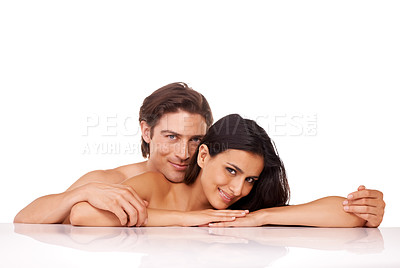 Buy stock photo Studio shot of a happy naked couple enjoying an intimate moment against a white background