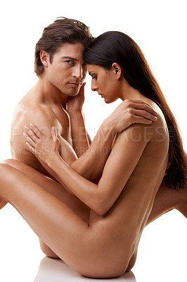 Buy stock photo Studio shot of a gorgeous naked couple sitting together against a white background