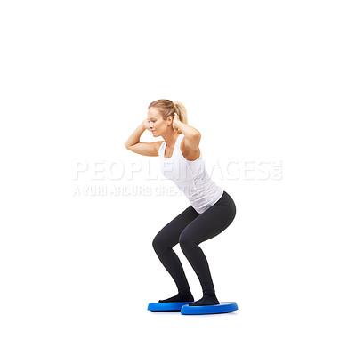 Buy stock photo Full length studio shot of a woman doing balance exercises isolated on white