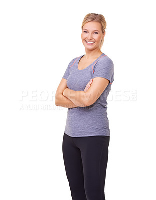 Buy stock photo Studio portrait of a sporty young woman smiling at the camera isolated on white