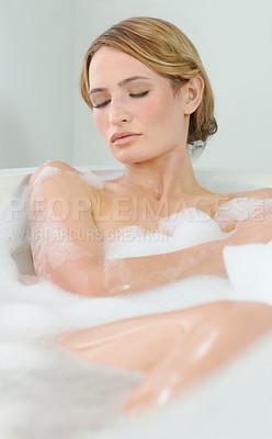 Buy stock photo A beautiful young woman closing her eyes and enjoying a luxurious bath