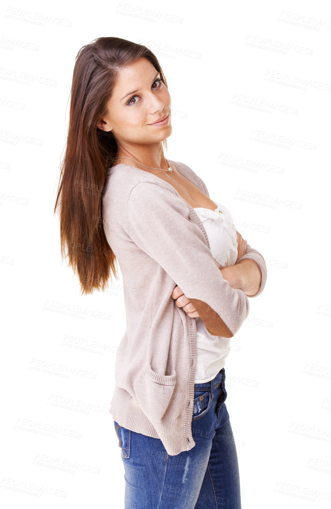 Buy stock photo Studio show of a beautiful young woman standing with her arms folded against a white background