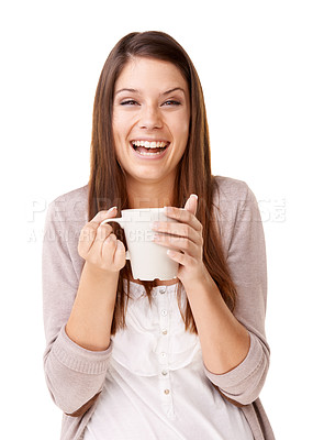 Buy stock photo Laughing young woman drinking a cup of coffee against a white background