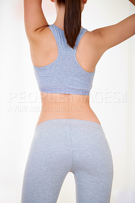 Buy stock photo Rearview of an attractive young woman in gymwear