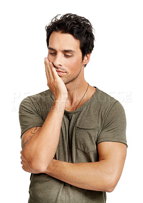 Buy stock photo A handsome young man looking pensive