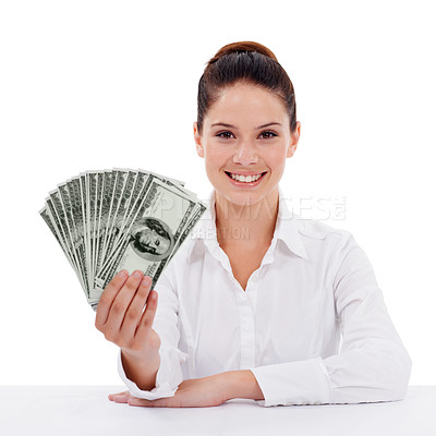 Buy stock photo Studio portrait of a young woman holding fanned-out dollar bills isolated on white