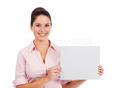 Buy stock photo Studio portrait of an attractive woman holding up a blank sign isolated on white