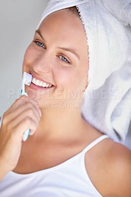 Buy stock photo Shot of a beautiful woman brushing her teeth