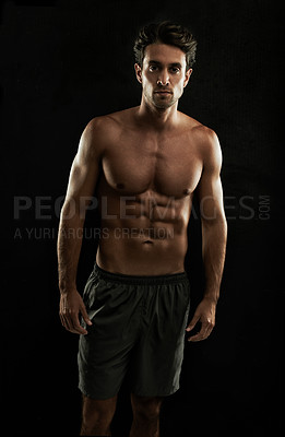 Buy stock photo Muscular young man showing off his sculpted body
