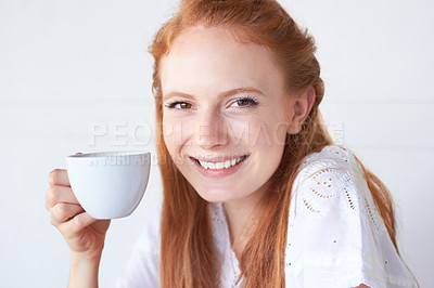 Buy stock photo Portrait of an attractive young woman drinking a cup of coffee