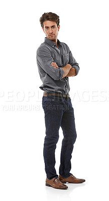 Buy stock photo Full-length portrait of a handsome young man standing with his arms folded