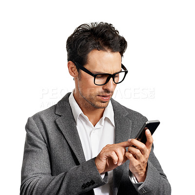 Buy stock photo A handsome young man dialing a number on his cellphone