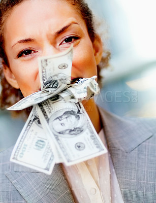 Buy stock photo Frustrated young business woman with money stuffed in her mouth