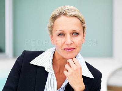 Buy stock photo Portrait of a confident middle age business woman with hand on chin
