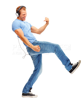 Buy stock photo Young smart man dancing and listening music, isolated on white