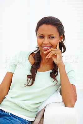 Buy stock photo A pretty African American young woman relaxing at home