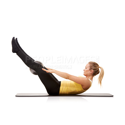 Buy stock photo A young woman working out with an exercise ball on a mat - isolated