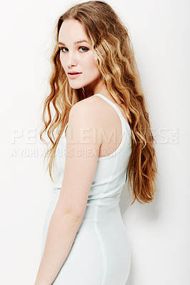 Buy stock photo Young woman posing stylishly against a white background