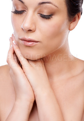 Buy stock photo A gorgeous young brunette looking downwards with her cheek resting against her hands