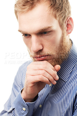 Buy stock photo A young man with his hand on his chin isolated on white