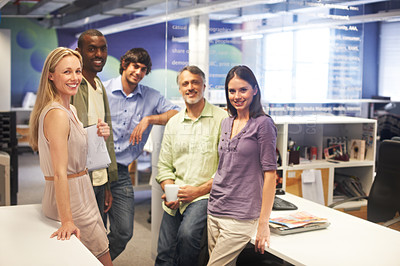 Buy stock photo Cropped portrait of a group of businesspeople standing in their office