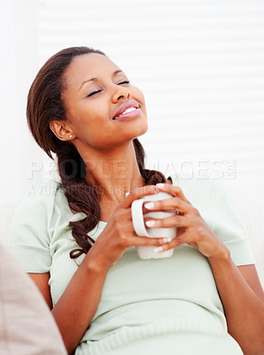 Buy stock photo Day dreaming - African American female relaxed at home, having a cup of coffee