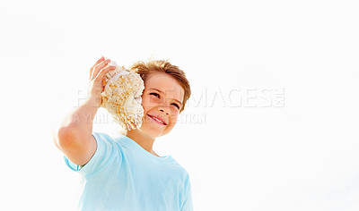 Buy stock photo Cute little child hearing a conch shell against a bright background