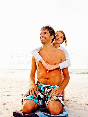 Buy stock photo Teenage daughter embracing her father from behind at the beach