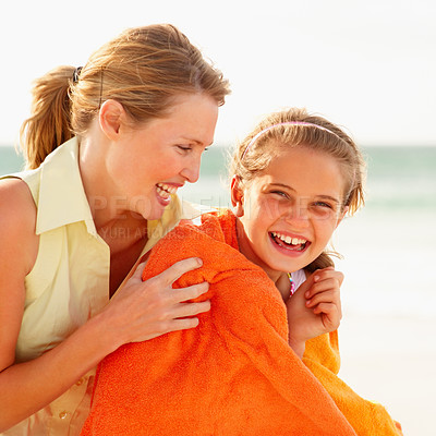 Buy stock photo Happy teen girl and her mother enjoying themselves on their beach vacation