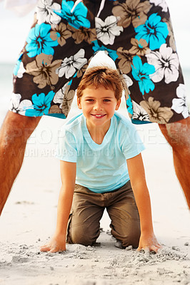 Buy stock photo Portrait of a cute small boy playing with his father at the sea shore