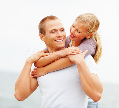 Buy stock photo Cute young female embracing her boyfriend from behind, outdoors