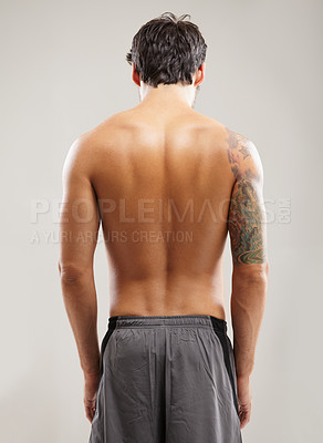 Buy stock photo Rearview of a shirtless man