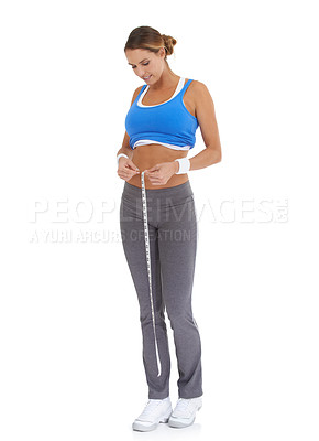 Buy stock photo Young woman in sportswear measuring her waistline while isolated on white