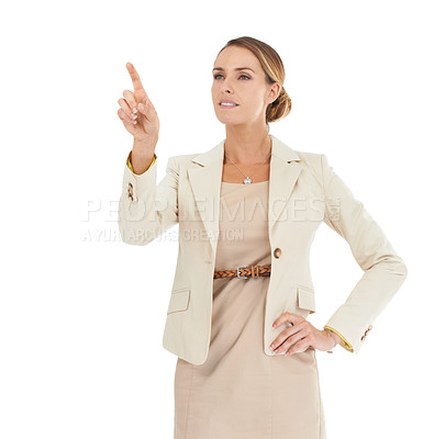 Buy stock photo A beautiful businesswoman touching an invisible screen