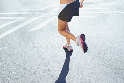 Buy stock photo Cropped shot of an athletic young woman running outdoors