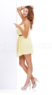 Buy stock photo Studio shot of an attractive young woman standing with a blank placard