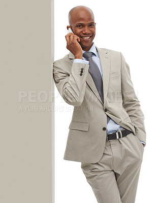 Buy stock photo An African-American businessman speaking on his cellphone