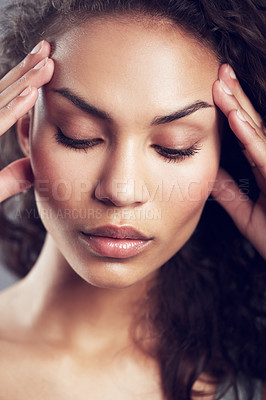 Buy stock photo A young woman with a headache