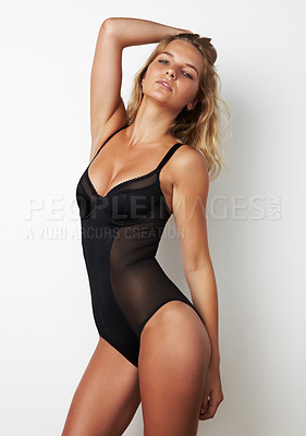 Buy stock photo A gorgeous model posing in a black bodysuit