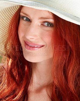 Buy stock photo A young redheade woman wearing a sunhat
