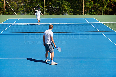 Buy stock photo People playing tennis on a tennis court