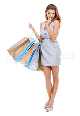 Buy stock photo Portrait of an attractive young woman telling you to hush while holding her shopping bags