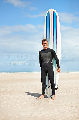 Buy stock photo Full length portrait of a surfer standing in front of his board