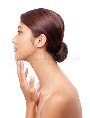 Buy stock photo Profile of a beautiful young woman touching her chin