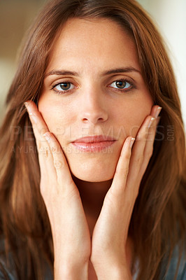 Buy stock photo Beautiful female model touching her face