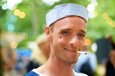 Buy stock photo Portrait of a handsome guy in a sailor outfit at a music festival