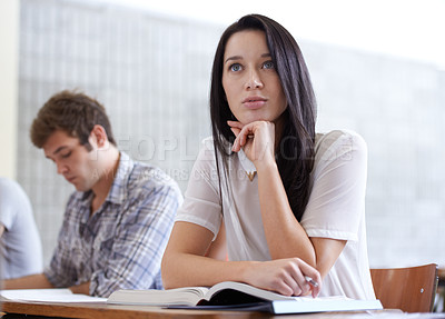 Buy stock photo Shot of young college student sitting in class deep in thought