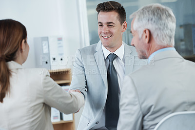Buy stock photo Shot of a business man shaking hands with a business female